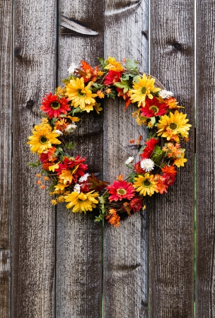 Autumn flower wreath on rustic wooden fence Stock Photo - 15292029