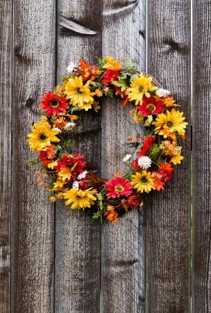 Autumn flower wreath on rustic wooden fence Stock Photo - 15292029