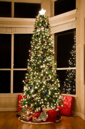 Christmas tree lit up in a beautiful home  photo