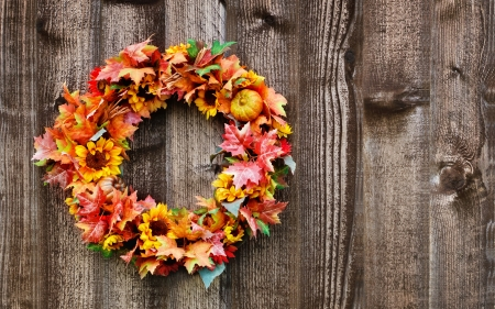 Autumn flower wreath on rustic wooden fence Stock Photo