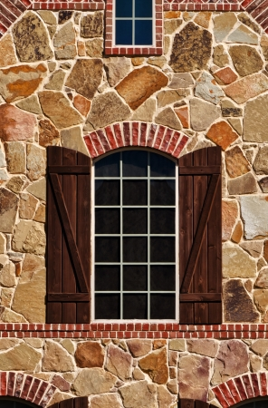 Window on stone wall of southern home Stock Photo
