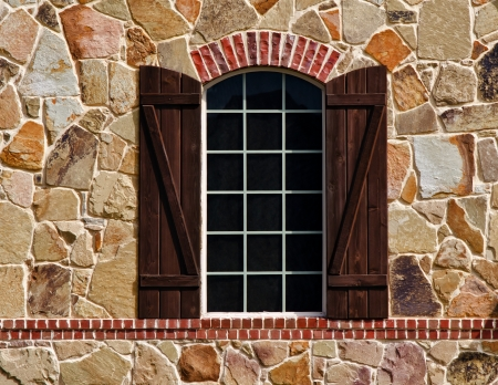 Window with shutters on stone wall of southern style home