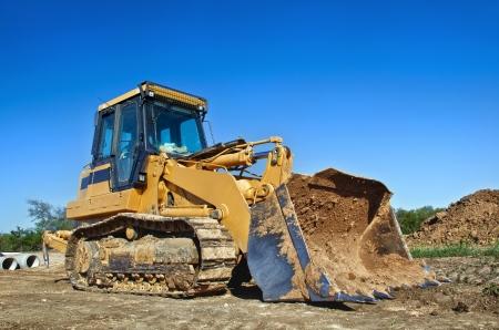backhoe loader: Yellow construction bulldozer