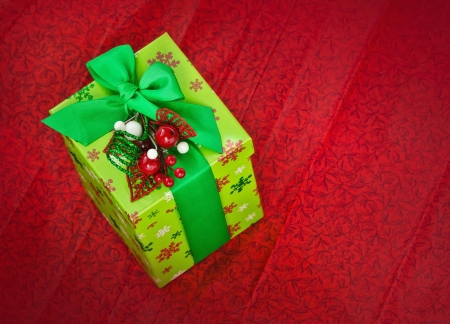 Christmas present on red background  photo