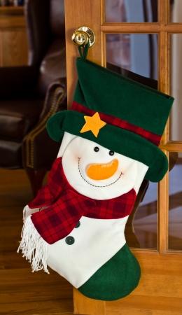 door knob: Christmas stocking hanging on door
