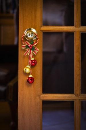 windows and doors: Christmas bells hanging on the door knob