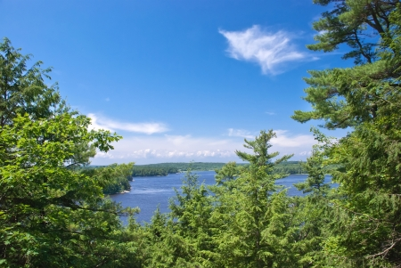 Scenic view across the river from top of the hill on a sunny summer day with blue sky and white clouds Stock Photo - 17185183