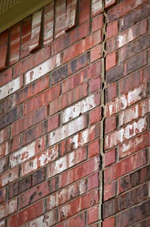 foundation problems: Foundation damage causing a gap on brick wall Stock Photo