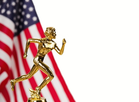 Golden runner trophy with blurred American flag on the background