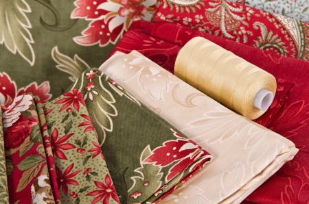 Quilting fabrics in different colors and patterns with quilting thread
