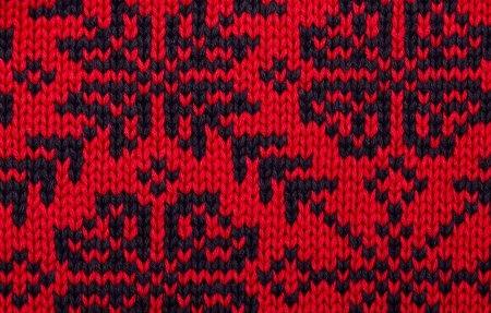 Knitting pattern closeup in red and blue for background