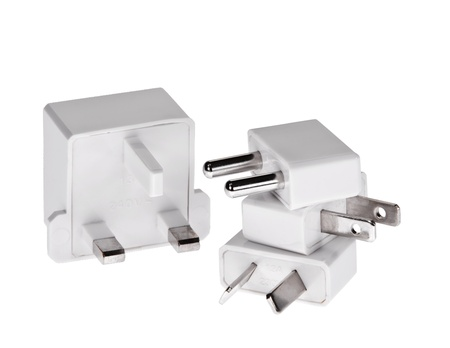 adapters: Travel adapters isolated over white