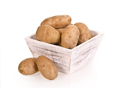 russet: Russet potatoes in white wooden container over white