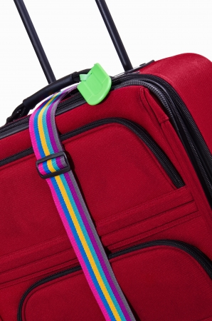 Closeup of bright green luggage tag and colorful belt on red suitcase Stock Photo - 18516434