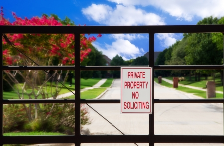 soliciting: No soliciting sign at a gate Stock Photo