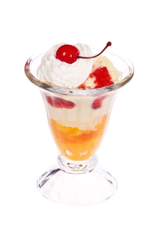 Vanilla peach melba ice cream with whipped cream and a cherry on the top isolated over white