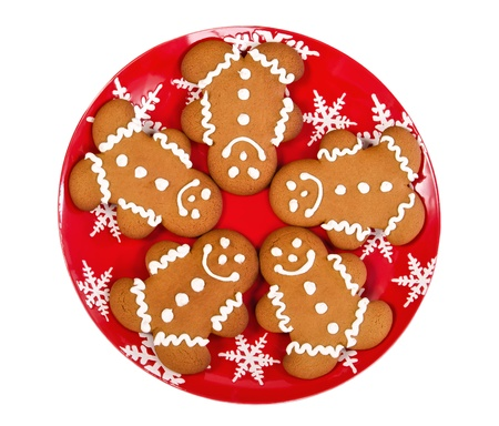 Gingerbread man cookies on red Christmas plate, isolated over white Stock Photo - 20323077