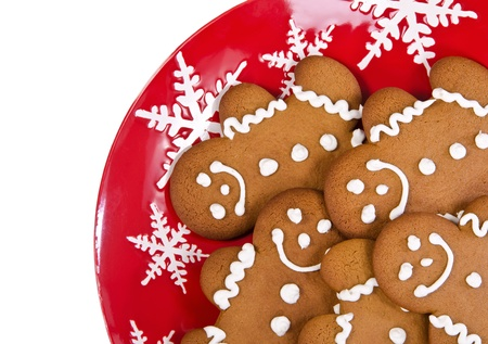 Closeup of gingerbread man cookies on red Christmas plate Stock Photo - 20323106