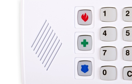 Closeup of home security alarm keypad with fire, police, and medical emergency buttons photo