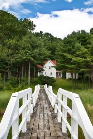 doubling: View from lighthouse bridge to keepers house at Doubling Point, Maine, on coastal New England