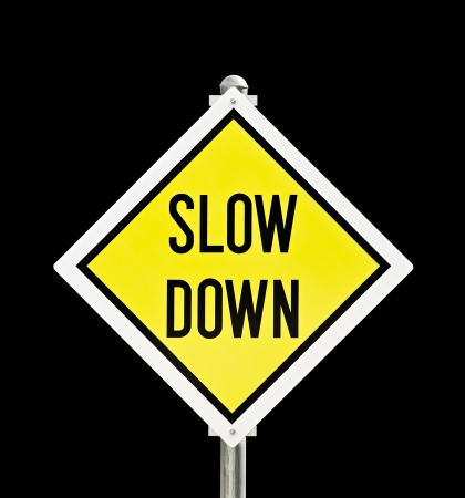 slow: Slow Down yellow road sign isolated over black  clipping path included