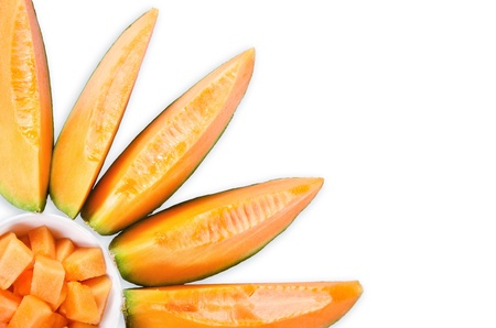 Cantaloupe melon slices in sun flower shape over white background Stock Photo