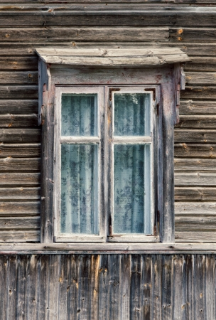 Window of an old wooden cottage photo