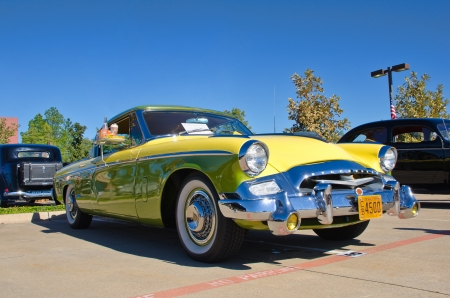 speedster: Westlake, Texas - October 19, 2013 - A 1955 Studebaker President Speedster, lemon-lime, is on display at the 3rd Annual Westlake Classic Car Show in Westlake, Texas Editorial