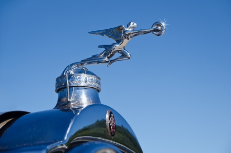 antique car: Westlake, Texas - October 19, 2013 - Hood ornament of a 1929 Packard automobile on display at the 3rd Annual Westlake Classic Car Show in Westlake, Texas