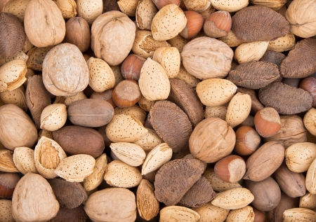 Mixed nuts background with almonds, walnuts, pecans, hazelnuts, and Brazil nuts