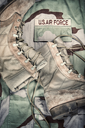 us air force: Old combat boots against US Air Force camouflage desert uniform  Vintage filter effects