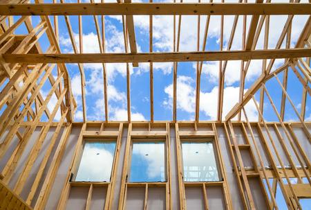 New construction home framing against sky