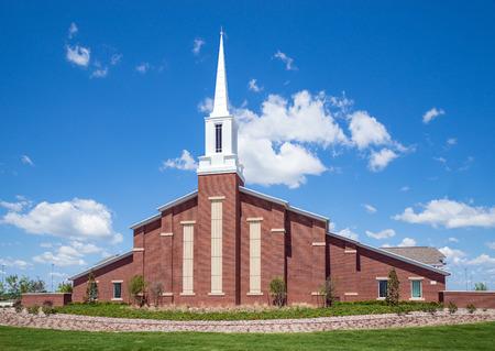 Mormon church against blue sky with white clouds  Archivio Fotografico