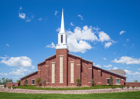 mormon: Mormon church against blue sky with white clouds  Stock Photo