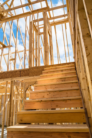 Unfinished residential construction house framing, closeup of interior stairs