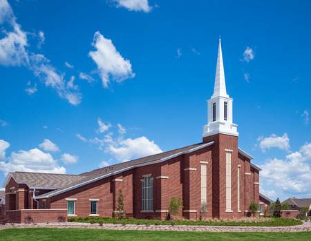 Mormon church against blue sky and white clouds