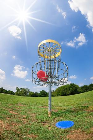 disc golf: Disc golf hole basket against blue sky