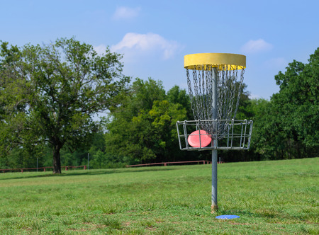 Disc golf hole basket in a park