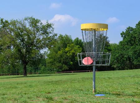 disc golf: Disc golf hole basket in a park