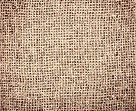 earth tone: Burlap textile background with vintage filter effects
