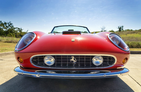 ferrari: WESTLAKE, TEXAS - OCTOBER 18, 2014: A red 1962 Ferrari 250 GT California Spyder is on display at the 4th Annual Westlake Classic Car Show. Front view.