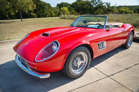 ferrari: WESTLAKE, TEXAS - OCTOBER 18, 2014: A red 1962 Ferrari 250 GT California Spyder is on display at the 4th Annual Westlake Classic Car Show. Front side view. Editorial