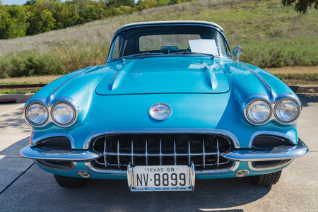 car front: WESTLAKE, TEXAS - OCTOBER 18, 2014: A turquoise 1959 Chevrolet Corvette Convertible is on display at the 4th Annual Westlake Classic Car Show. Front view.