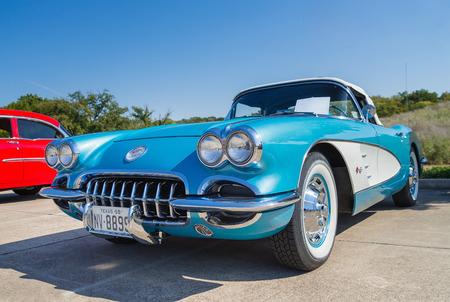 chevrolet: WESTLAKE, TEXAS - OCTOBER 18, 2014: A turquoise 1959 Chevrolet Corvette Convertible is on display at the 4th Annual Westlake Classic Car Show. Front view.