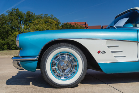 WESTLAKE, TEXAS - OCTOBER 18, 2014: A turquoise 1959 Chevrolet Corvette Convertible is on display at the 4th Annual Westlake Classic Car Show. Closeup of front side view.