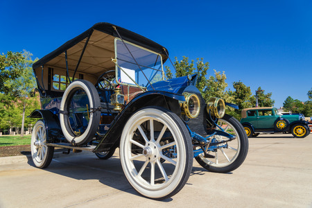 touring car: WESTLAKE, TEXAS - OCTOBER 18, 2014: A 1911 Cadillac 30 Touring is on display at the 4th Annual Westlake Classic Car Show. Front side view.