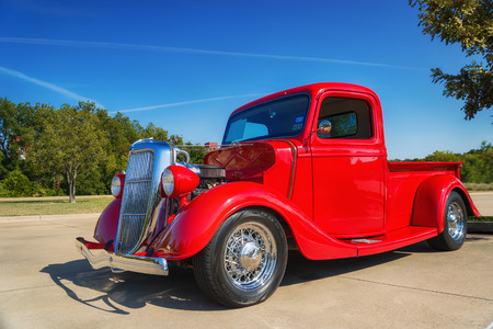 WESTLAKE, TEXAS - OCTOBER 18, 2014: A red 1935 Ford pickup truck is on display at the 4th Annual Westlake Classic Car Show. Front side view.