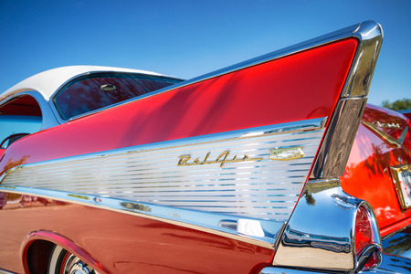 car detail: WESTLAKE, TEXAS - OCTOBER 18, 2014: Tail fin and taillight details of a red 1957 Chevrolet Bel Air classic car.