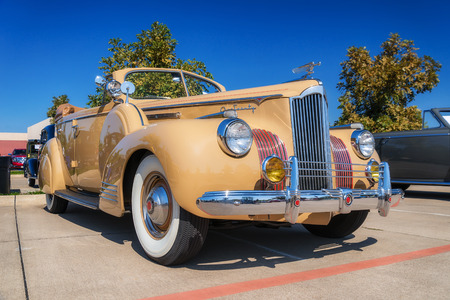 front view: WESTLAKE, TEXAS - OCTOBER 18, 2014: A 1941 Packard 120 (One-Twenty) Convertible Sedan is on display at the 4th Annual Westlake Classic Car Show. Front side view.