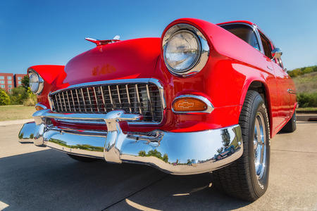 WESTLAKE, TEXAS - OCTOBER 18, 2014: A red 1955 Chevrolet 210 is on display at the 4th Annual Westlake Classic Car Show. Front view closeup.